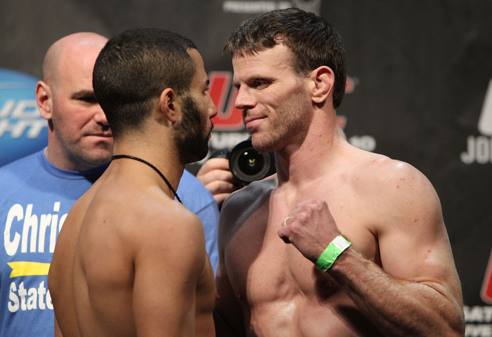 TORONTO, ON - DECEMBER 09: John Makdessi faces off with Dennis Hallman during the UFC 140 Official Weigh-in at the Air Canada Centre on December 9, 2011 in Toronto, Canada. (Photo by Josh Hedges/Zuffa LLC/Zuffa LLC via Getty Images)