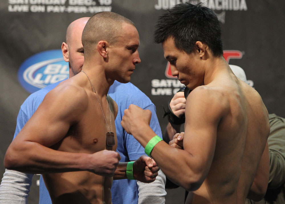 TORONTO, ON - DECEMBER 09:  (L-R) Featherweight opponents Mark Hominick and Chan Sung Jung face off after weighing in during the UFC 140 Official Weigh-in at the Air Canada Centre on December 9, 2011 in Toronto, Canada.  (Photo by Josh Hedges/Zuffa LLC/Zuffa LLC via Getty Images)