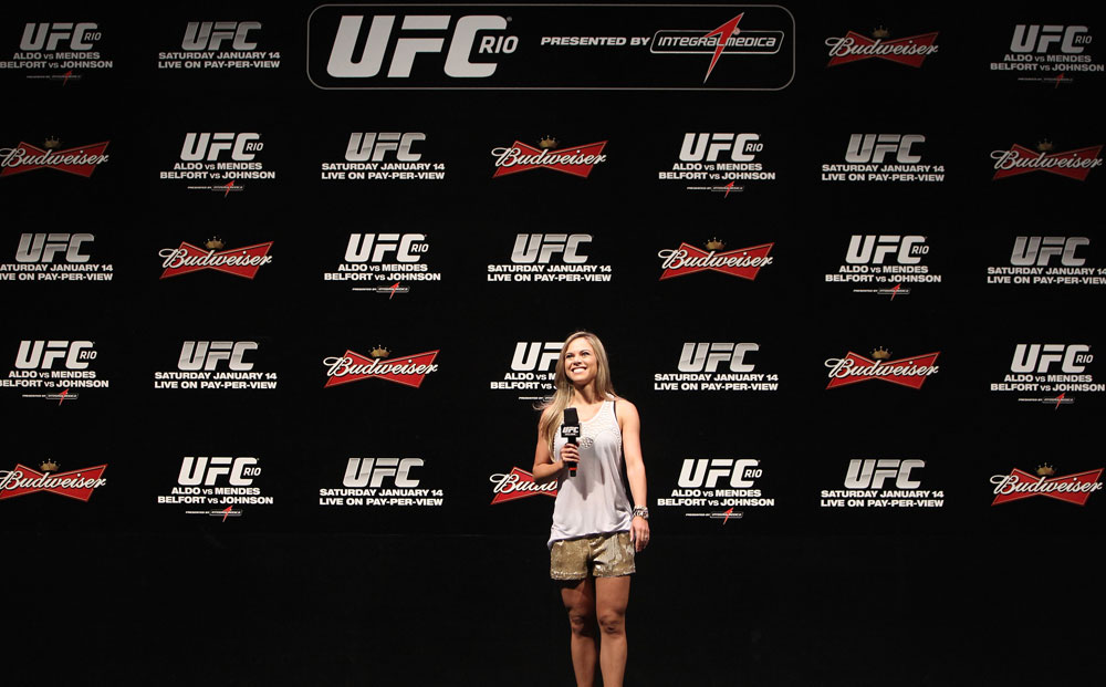 RIO DE JANEIRO, BRAZIL - JANUARY 13:  UFC Brazil host Paula Sack conducts a Q&A session with UFC Heavyweight Champion Junior dos Santos before the UFC 142 Weigh In at HSBC Arena on January 13, 2012 in Rio de Janeiro, Brazil.  (Photo by Josh Hedges/Zuffa LLC/Zuffa LLC via Getty Images)