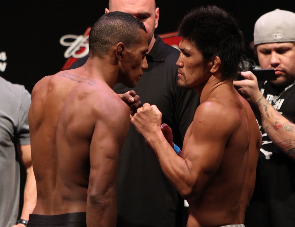 RIO DE JANEIRO, BRAZIL - JANUARY 13:  (L-R) Opponents Yuri Alcantara and Michihiro Omigawa face off after weighing in during the UFC 142 Weigh In at HSBC Arena on January 13, 2012 in Rio de Janeiro, Brazil.  (Photo by Josh Hedges/Zuffa LLC/Zuffa LLC via Getty Images)