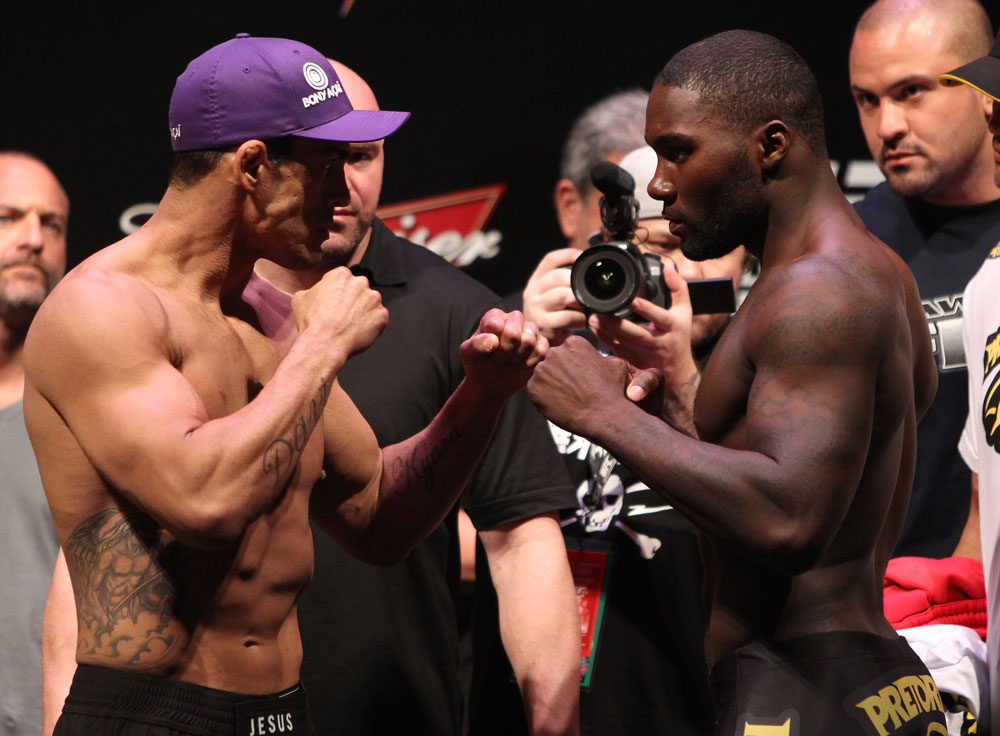 RIO DE JANEIRO, BRAZIL - JANUARY 13:  (L-R) Opponents Vitor Belfort and Anthony Johnson face off after weighing in during the UFC 142 Weigh In at HSBC Arena on January 13, 2012 in Rio de Janeiro, Brazil.  (Photo by Josh Hedges/Zuffa LLC/Zuffa LLC via Getty Images)