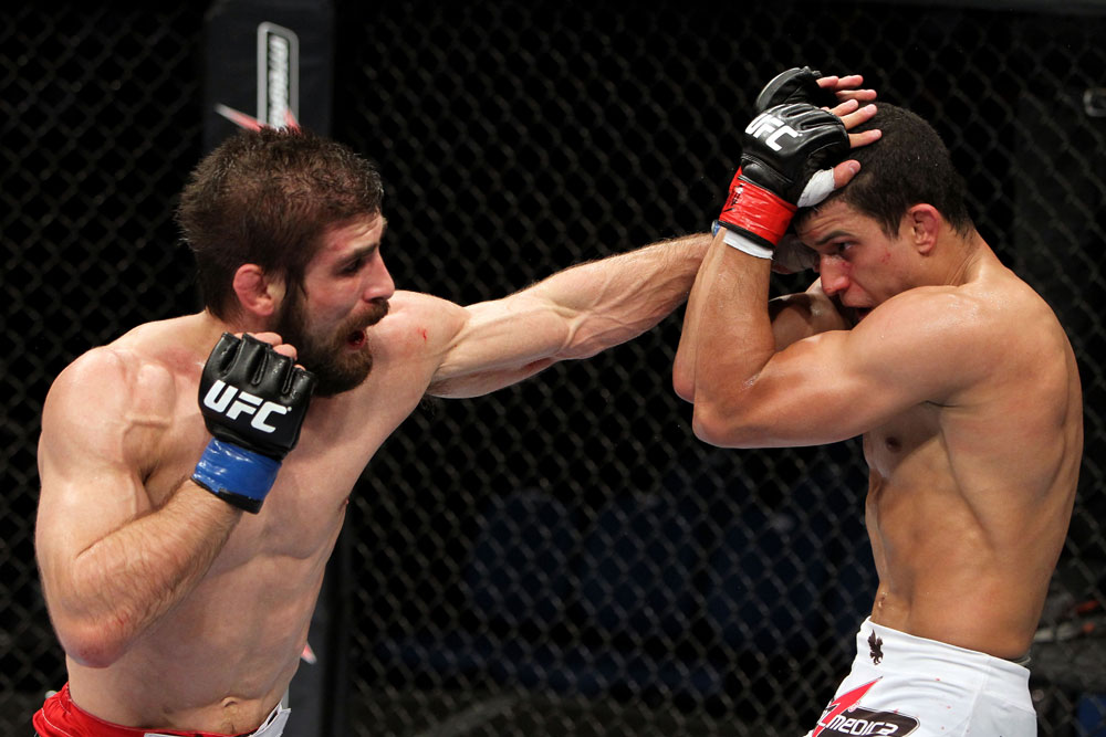RIO DE JANEIRO, BRAZIL - JANUARY 14:  Antonio Carvalho (L) punches Felipe Arantes (R) in a featherweight bout during UFC 142 at HSBC Arena on January 14, 2012 in Rio de Janeiro, Brazil.  (Photo by Josh Hedges/Zuffa LLC/Zuffa LLC via Getty Images)