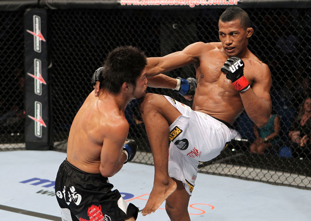 RIO DE JANEIRO, BRAZIL - JANUARY 14:  Yuri Alcantara knees Michihiro Omigawa in a featherweight bout during UFC 142 at HSBC Arena on January 14, 2012 in Rio de Janeiro, Brazil.  (Photo by Josh Hedges/Zuffa LLC/Zuffa LLC via Getty Images)