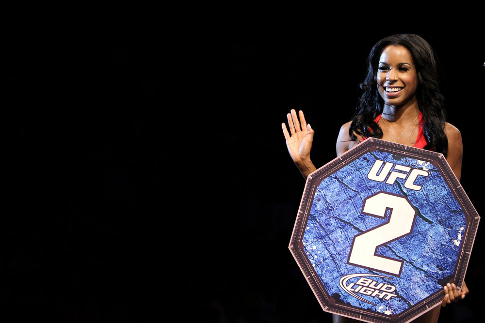RIO DE JANEIRO, BRAZIL - JANUARY 14:  UFC Octagon Girl Chandella Powell looks on during the Felipe Arantes versus Antonio Carvalho in a featherweight bout during UFC 142 at HSBC Arena on January 14, 2012 in Rio de Janeiro, Brazil.  (Photo by Josh Hedges/Zuffa LLC/Zuffa LLC via Getty Images)