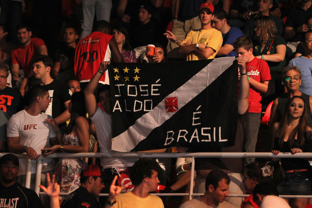 RIO DE JANEIRO, BRAZIL - JANUARY 14:  Fans cheer prior to the Jose Aldo versus Chad Mendes featherweight bout during UFC 142 at HSBC Arena on January 14, 2012 in Rio de Janeiro, Brazil.  (Photo by Josh Hedges/Zuffa LLC/Zuffa LLC via Getty Images)