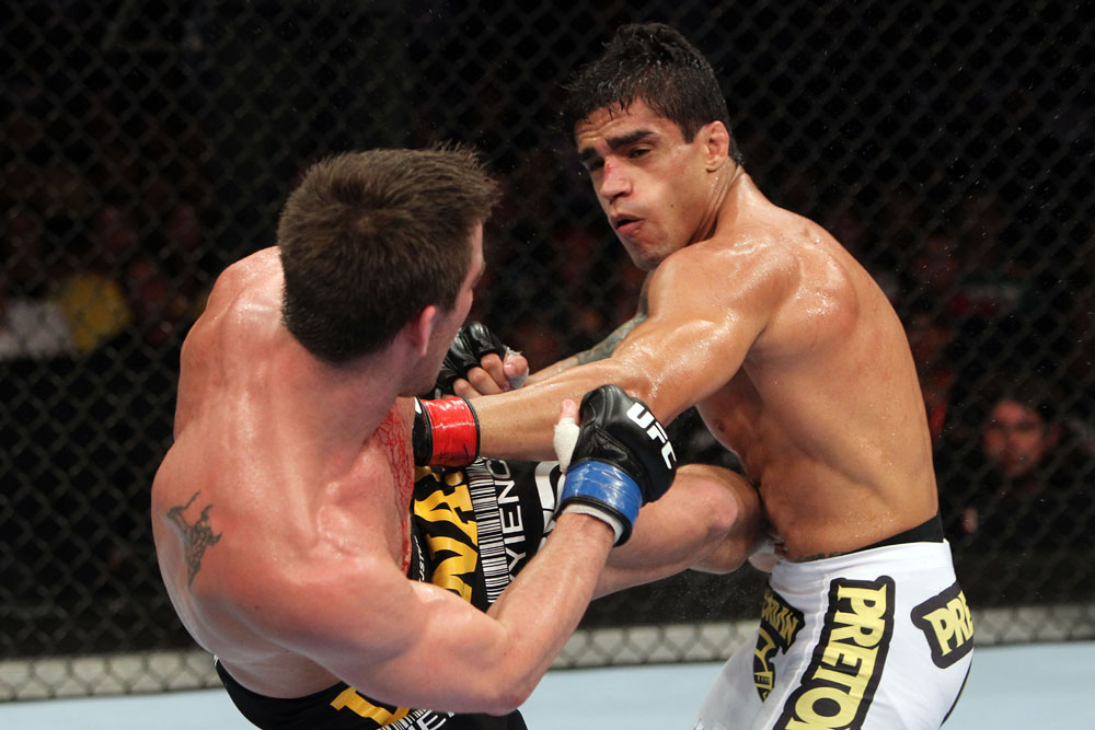RIO DE JANEIRO, BRAZIL - JANUARY 14:  Thiago Tavares (R) punches Sam Stout (L) in a lightweight bout during UFC 142 at HSBC Arena on January 14, 2012 in Rio de Janeiro, Brazil.  (Photo by Josh Hedges/Zuffa LLC/Zuffa LLC via Getty Images)