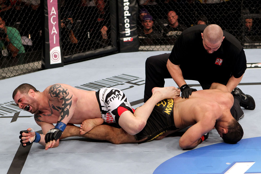 RIO DE JANEIRO, BRAZIL - JANUARY 14: Rousimar Palhares submits Mike Massenzio in a middleweight bout during UFC 142 at HSBC Arena on January 14, 2012 in Rio de Janeiro, Brazil. (Photo by Josh Hedges/Zuffa LLC/Zuffa LLC via Getty Images)