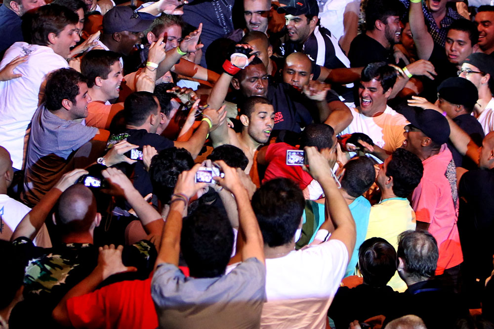 RIO DE JANEIRO, BRAZIL - JANUARY 14:  Jose Aldo (C) celebrates in the crowd after defeating Chad Mendes in a featherweight bout during UFC 142 at HSBC Arena on January 14, 2012 in Rio de Janeiro, Brazil.  (Photo by Josh Hedges/Zuffa LLC/Zuffa LLC via Getty Images)