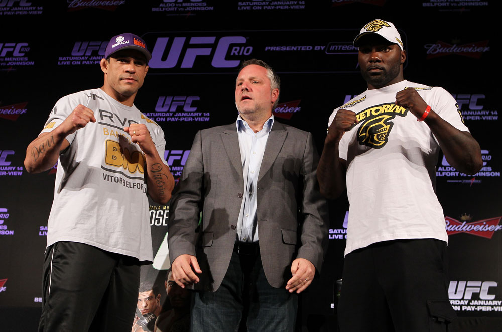 RIO DE JANEIRO, BRAZIL - JANUARY 12:  (L-R) Opponents Vitor Belfort and Anthony Johnson pose for photos during the final UFC 142 pre-fight press conference at the Copacabana Palace Hotel on January 12, 2012 in Rio de Janeiro, Brazil.  (Photo by Josh Hedges/Zuffa LLC/Zuffa LLC via Getty Images)