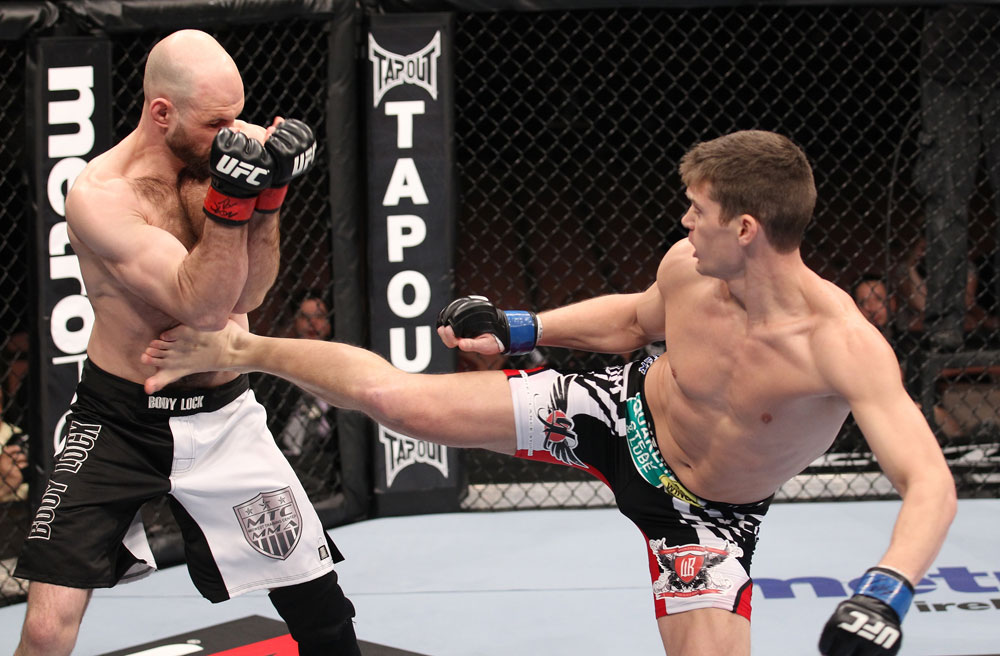 LAS VEGAS, NV - FEBRUARY 04:  Stephen Thompson (right) kicks Dan Stittgen during the UFC 143 event at Mandalay Bay Events Center on February 4, 2012 in Las Vegas, Nevada.  (Photo by Nick Laham/Zuffa LLC/Zuffa LLC via Getty Images) *** Local Caption *** Stephen Thompson; Dan Stittgen