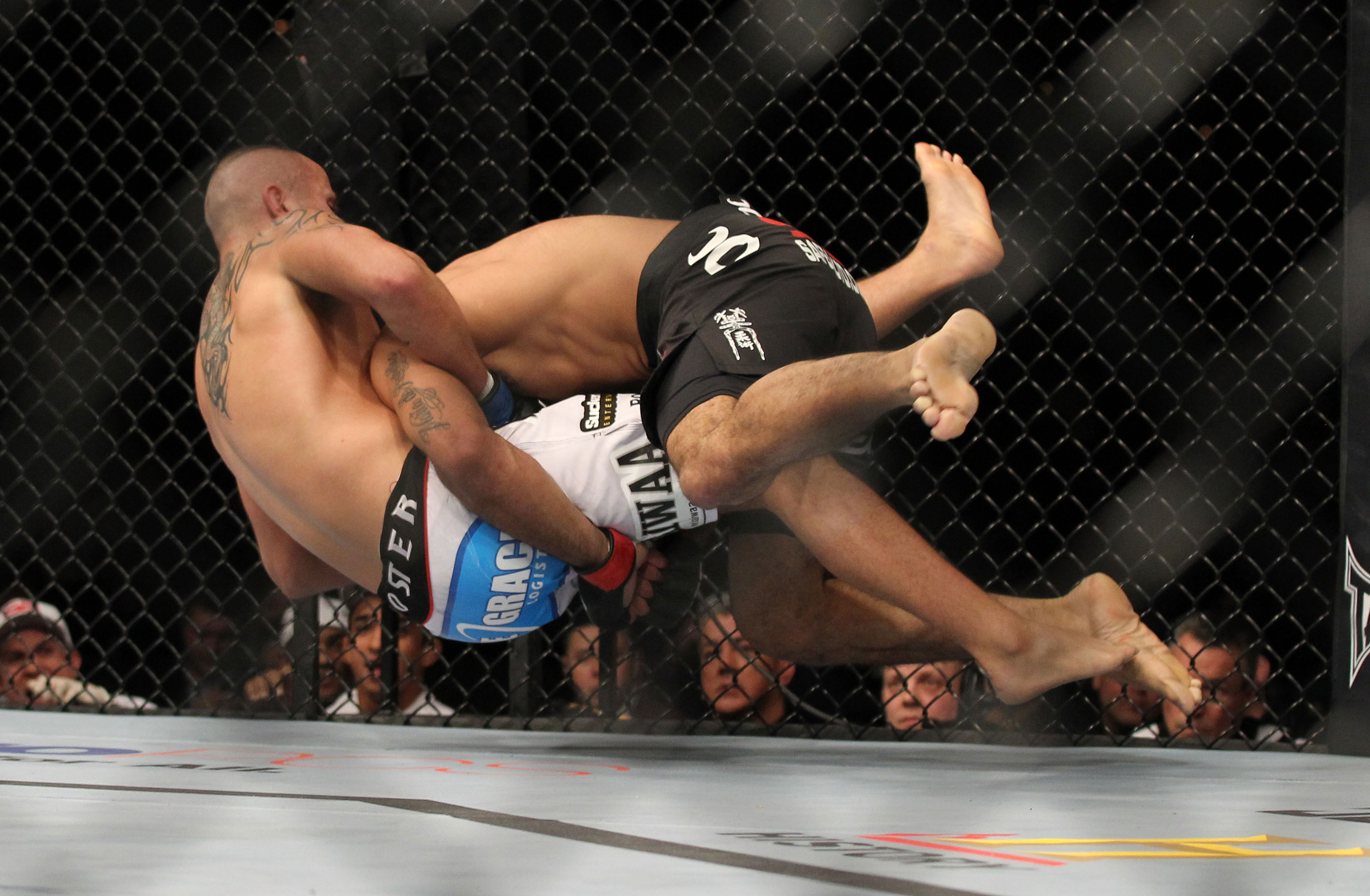 LAS VEGAS, NV - FEBRUARY 04:  Rafael Natal (black shorts) takes down Michael Kuiper during the UFC 143 event at Mandalay Bay Events Center on February 4, 2012 in Las Vegas, Nevada.  (Photo by Josh Hedges/Zuffa LLC/Zuffa LLC via Getty Images) *** Local Caption *** Rafael Natal; Michael Kuiper
