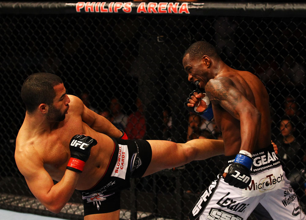 ATLANTA, GA - APRIL 21:  John Makdessi (L) kicks Anthony Njokuani during their lightweight bout for UFC 145 at Philips Arena on April 21, 2012 in Atlanta, Georgia.  (Photo by Al Bello/Zuffa LLC/Zuffa LLC via Getty Images)