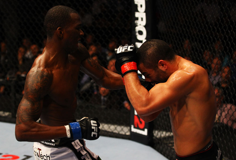 ATLANTA, GA - APRIL 21:  Anthony Njokuani (L) punches John Makdessi during their lightweight bout for UFC 145 at Philips Arena on April 21, 2012 in Atlanta, Georgia.  (Photo by Al Bello/Zuffa LLC/Zuffa LLC via Getty Images)