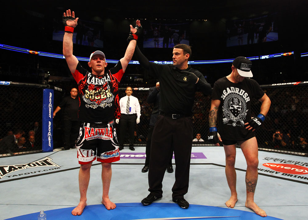 ATLANTA, GA - APRIL 21:  Mark Bocek (L) celebrates defeating John Alessio (R) by unanimous decision during their lightweight bout for UFC 145 at Philips Arena on April 21, 2012 in Atlanta, Georgia.  (Photo by Al Bello/Zuffa LLC/Zuffa LLC via Getty Images)