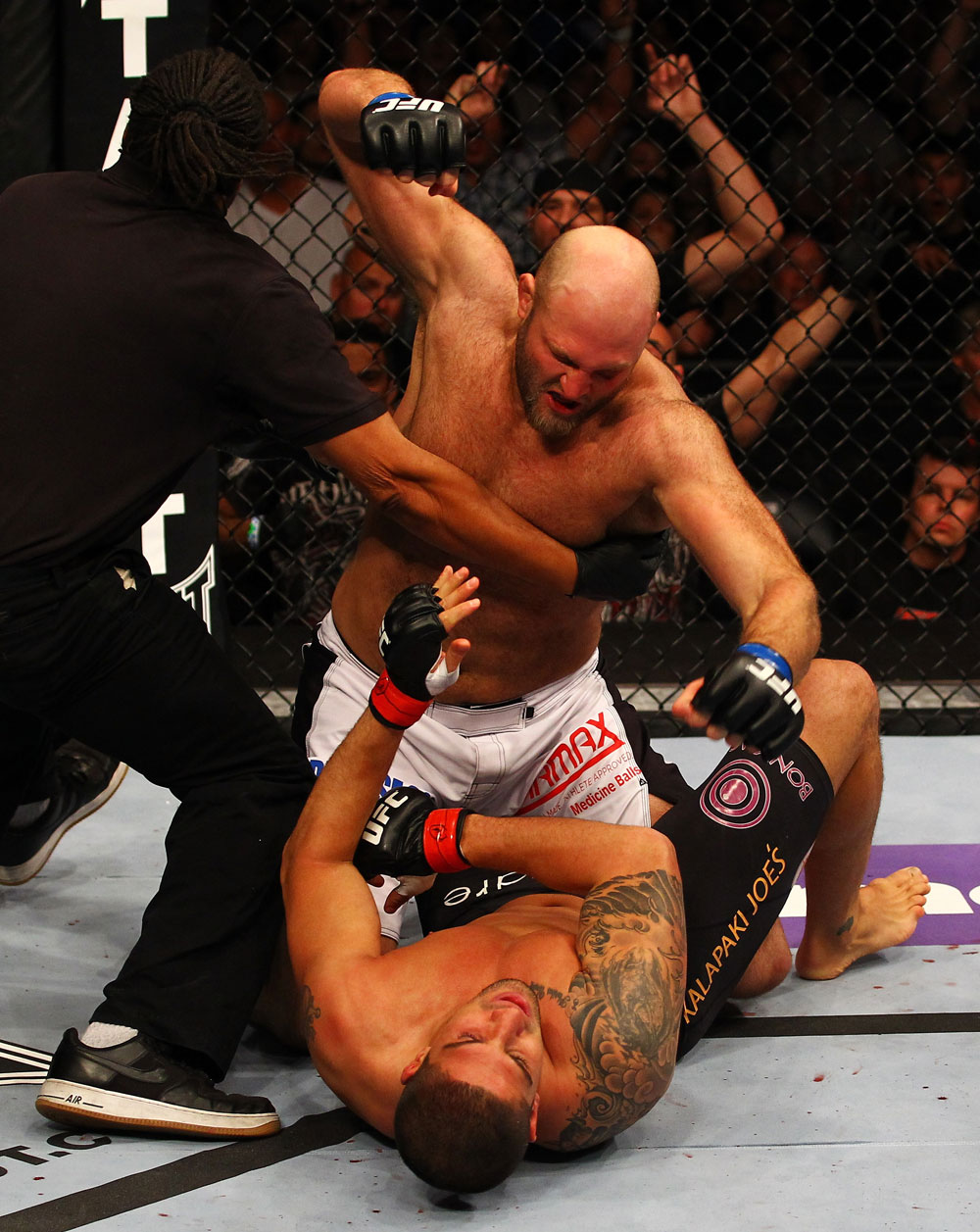 ATLANTA, GA - APRIL 21:  The official stops the fight as Ben Rothwell (top) punches Brendan Schaub during their heavyweight bout for UFC 145 at Philips Arena on April 21, 2012 in Atlanta, Georgia.  (Photo by Al Bello/Zuffa LLC/Zuffa LLC via Getty Images)