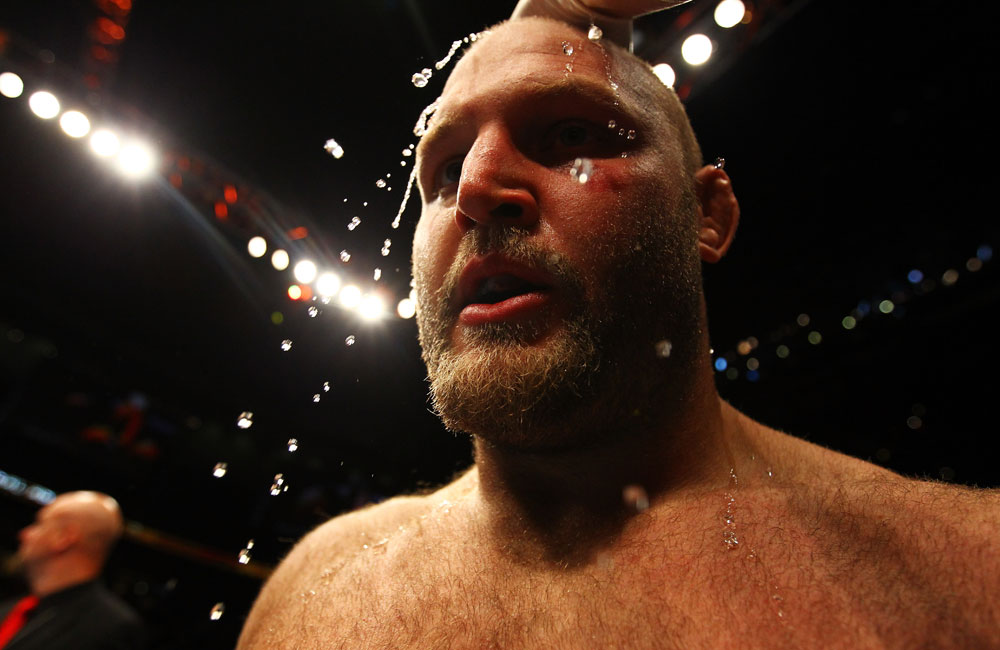 ATLANTA, GA - APRIL 21:  Water is applied to Ben Rothwell&#39;s head after he defeated Brendan Schaub by TKO in the first round of their heavyweight bout for UFC 145 at Philips Arena on April 21, 2012 in Atlanta, Georgia.  (Photo by Al Bello/Zuffa LLC/Zuffa LLC via Getty Images)