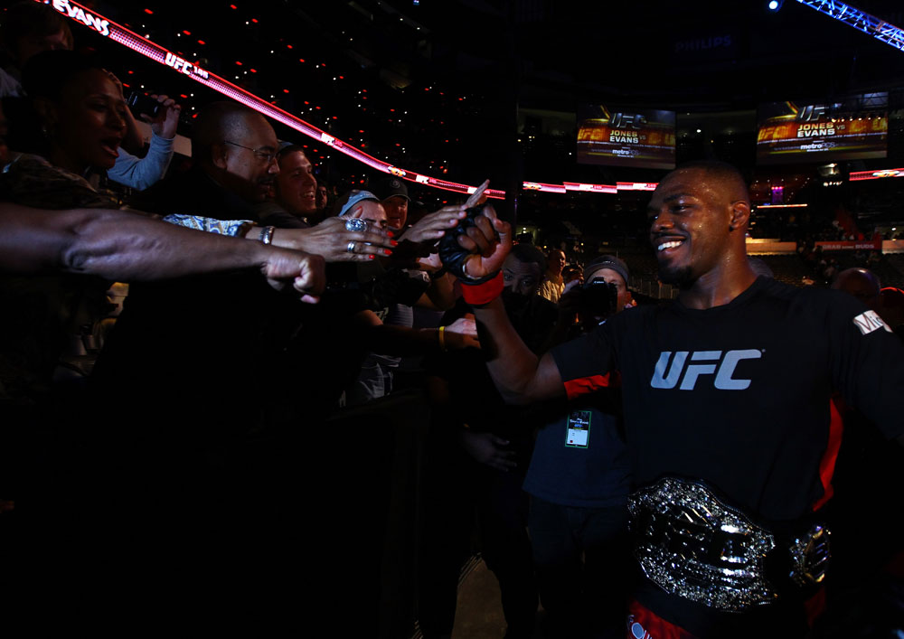 ATLANTA, GA - APRIL 21:  Jon Jones celebrates with fans after defeating Rashad Evans by unanimous decision in their light heavyweight title bout for UFC 145 at Philips Arena on April 21, 2012 in Atlanta, Georgia.  (Photo by Al Bello/Zuffa LLC/Zuffa LLC via Getty Images)