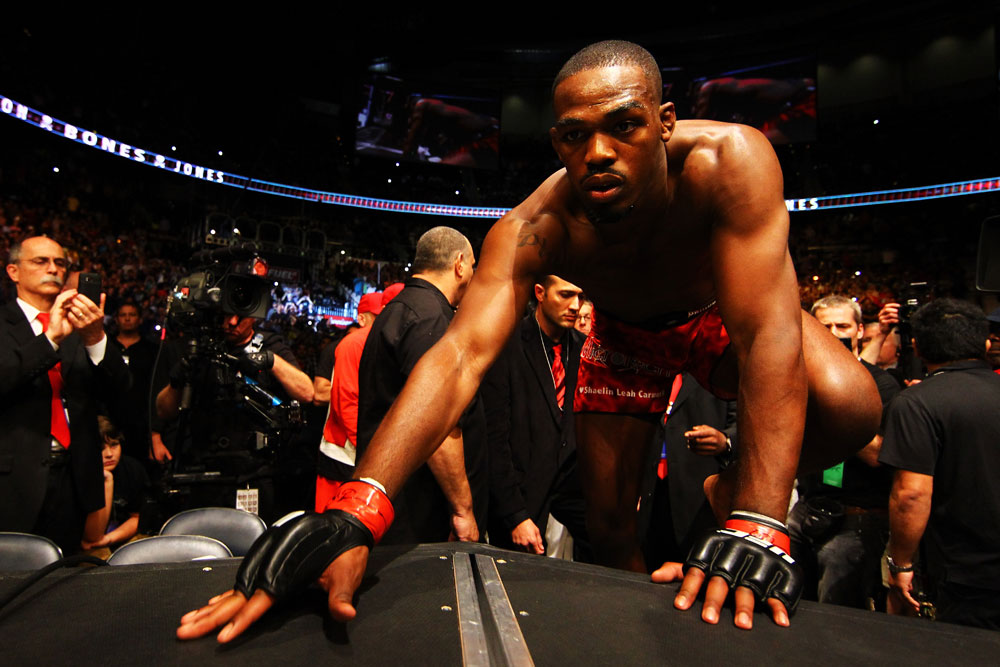 ATLANTA, GA - APRIL 21:  Jon Jones climbs into the octagon for his light heavyweight title bout with Rashad Evans for UFC 145 at Philips Arena on April 21, 2012 in Atlanta, Georgia.  (Photo by Al Bello/Zuffa LLC/Zuffa LLC via Getty Images)
