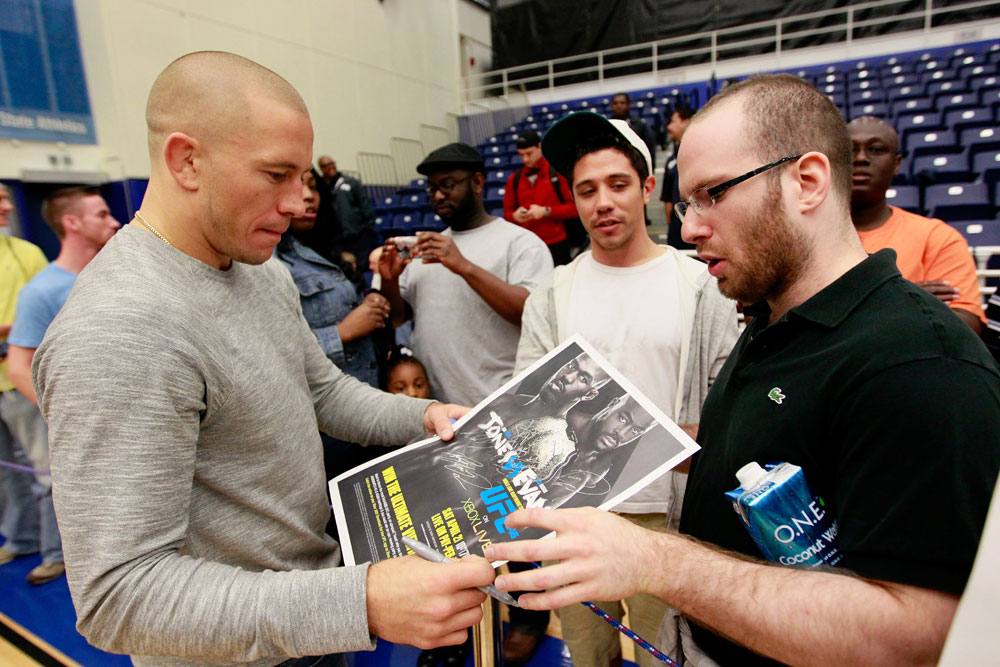 ATLANTA, GA - APRIL 19:  Georges St-Pierre of Canada signs autographs during UFC 145 open workouts at GSU Sports Arena on April 19, 2012 in Atlanta, Georgia.  (Photo by Kevin C. Cox/Zuffa LLC/Zuffa LLC via Getty Images)