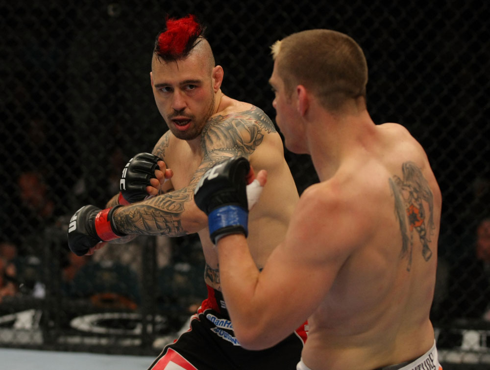 LAS VEGAS, NV - MAY 26:  Dan Hardy (L) throws a punch at Duane Ludwig during a welterweight bout at UFC 146 at MGM Grand Garden Arena on May 26, 2012 in Las Vegas, Nevada.  (Photo by Donald Miralle/Zuffa LLC/Zuffa LLC via Getty Images)