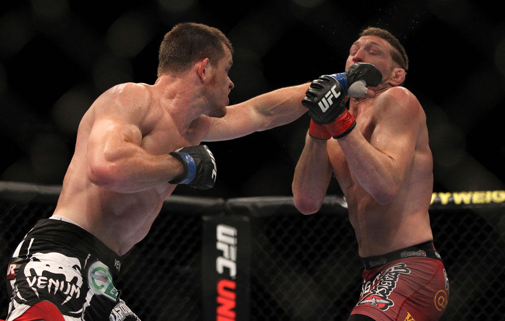 LAS VEGAS, NV - MAY 26:  CB Dollaway (left) punches Jason Miller during a middleweight bout at UFC 146 at MGM Grand Garden Arena on May 26, 2012 in Las Vegas, Nevada.  (Photo by Josh Hedges/Zuffa LLC/Zuffa LLC via Getty Images)