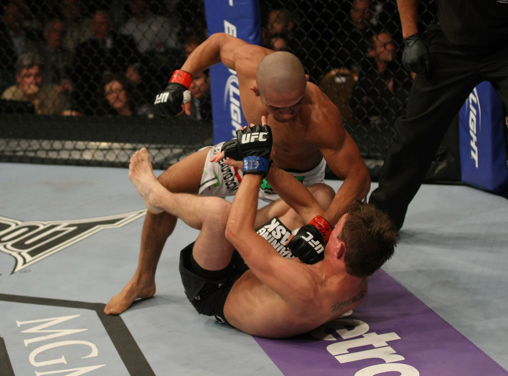 LAS VEGAS, NV - MAY 26:  Diego Brandao (top) punches Darren Elkins during a featherweight bout at UFC 146 at MGM Grand Garden Arena on May 26, 2012 in Las Vegas, Nevada.  (Photo by Donald Miralle/Zuffa LLC/Zuffa LLC via Getty Images)