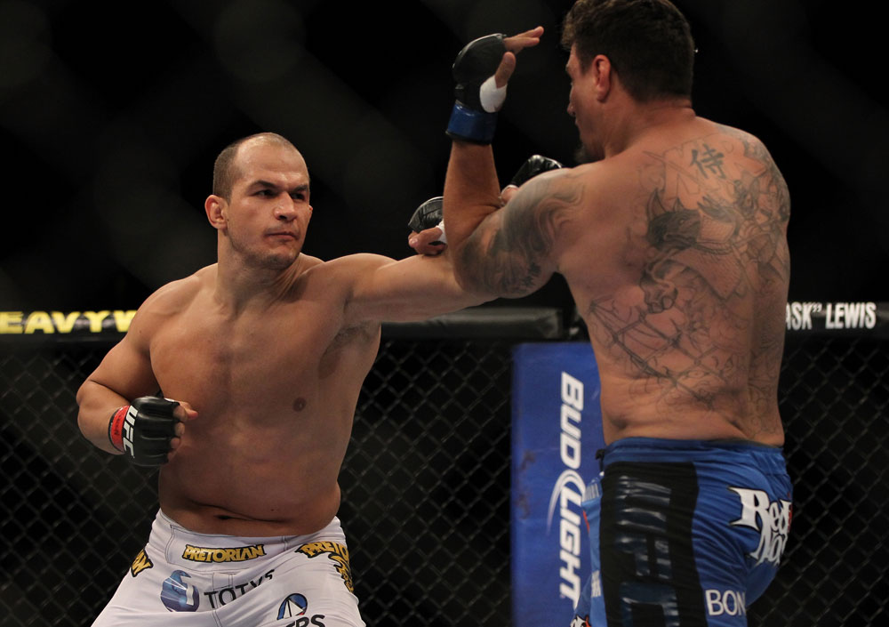 LAS VEGAS, NV - MAY 26:  (L-R) Junior dos Santos punches Frank Mir during the Heavyweight Championship bout at UFC 146 at MGM Grand Garden Arena on May 26, 2012 in Las Vegas, Nevada.  (Photo by Josh Hedges/Zuffa LLC/Zuffa LLC via Getty Images)
