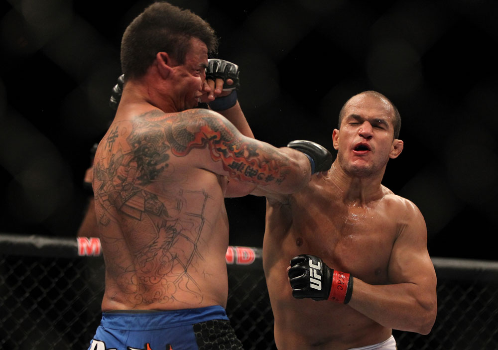 LAS VEGAS, NV - MAY 26:  (R-L) Junior dos Santos punches Frank Mir during the Heavyweight Championship bout at UFC 146 at MGM Grand Garden Arena on May 26, 2012 in Las Vegas, Nevada.  (Photo by Josh Hedges/Zuffa LLC/Zuffa LLC via Getty Images)