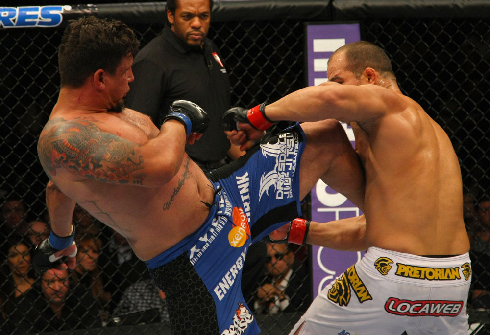 LAS VEGAS, NV - MAY 26:  Frank Mir (L) kicks Junior dos Santos during the Heavyweight Championship bout at UFC 146 at MGM Grand Garden Arena on May 26, 2012 in Las Vegas, Nevada. (Photo by Donald Miralle/Zuffa LLC/Zuffa LLC via Getty Images)