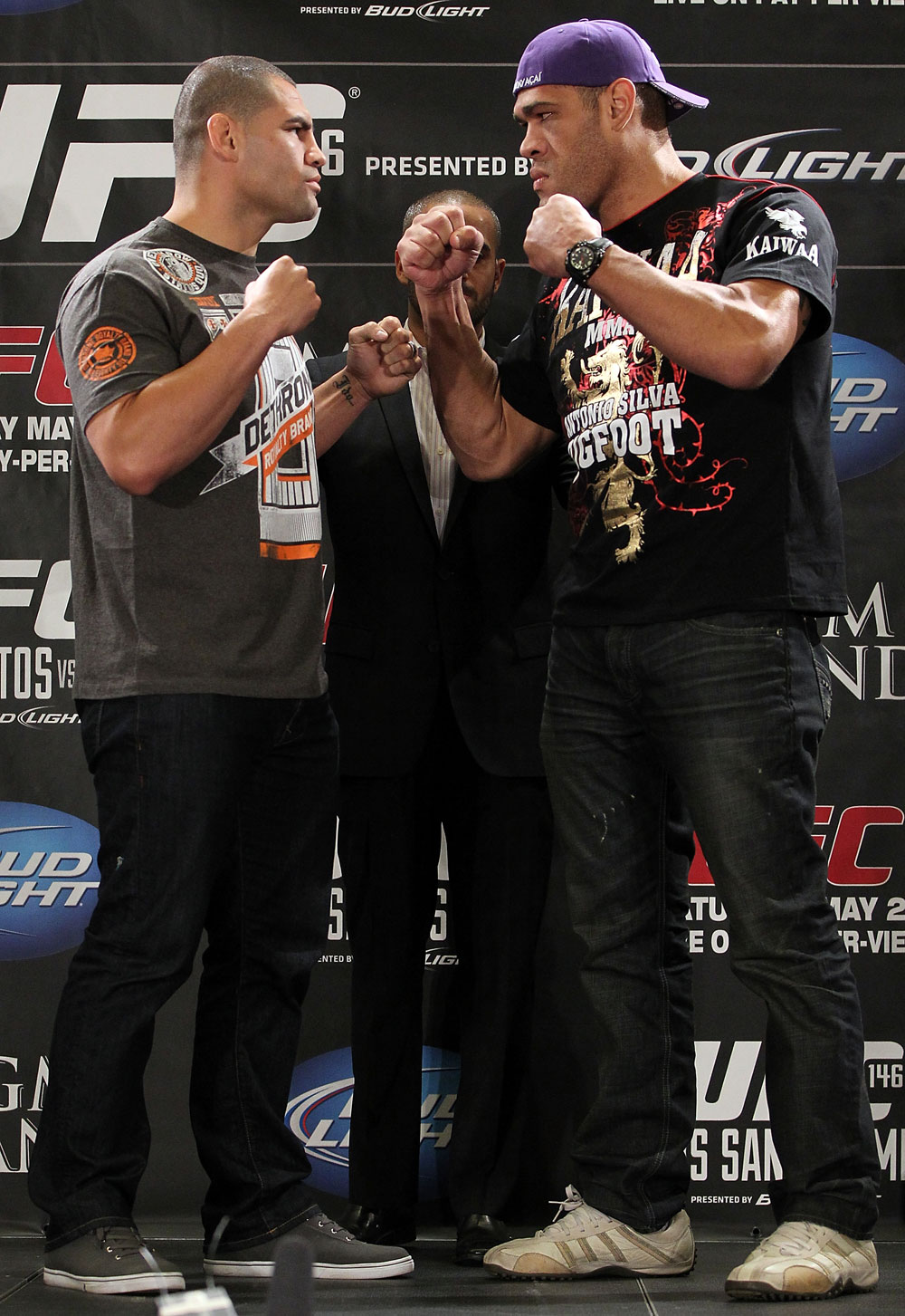 "LAS VEGAS, NV - MAY 24:   (L-R) Opponents Cain Velasquez and Antonio ""Big Foot"" Silva face off during the UFC 146 press conference at MGM Grand on May 24, 2012 in Las Vegas, Nevada.  (Photo by Josh Hedges/Zuffa LLC/Zuffa LLC via Getty Images)"