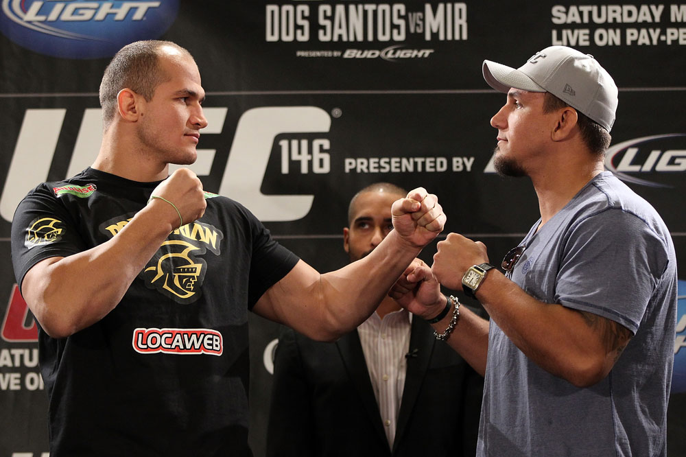 LAS VEGAS, NV - MAY 24:   (L-R) UFC Heavyweight Champion Junior dos Santos and challenger Frank Mir face off during the UFC 146 press conference at MGM Grand on May 24, 2012 in Las Vegas, Nevada.  (Photo by Josh Hedges/Zuffa LLC/Zuffa LLC via Getty Images)