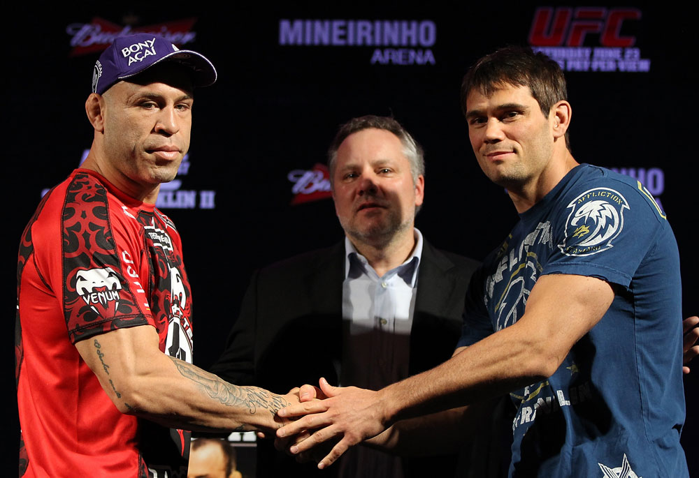 BELO HORIZONTE, BRAZIL - JUNE 21:   (L-R) Opponents Wanderlei Silva and Rich Franklin shake hands during the UFC 147 press conference at Ouro Minas Palace on June 21, 2012 in Belo Horizonte, Brazil.  (Photo by Josh Hedges/Zuffa LLC/Zuffa LLC via Getty Images)