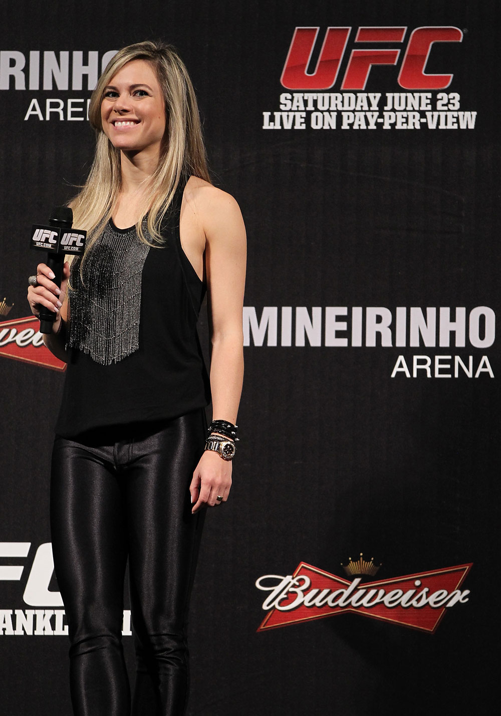BELO HORIZONTE, BRAZIL - JUNE 22:   Paula Sack hosts a Q&A session before the UFC 147 weigh in at Estádio Jornalista Felipe Drummond on June 22, 2012 in Belo Horizonte, Brazil.  (Photo by Josh Hedges/Zuffa LLC/Zuffa LLC via Getty Images)