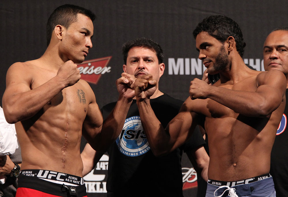 "BELO HORIZONTE, BRAZIL - JUNE 22:   (L-R) Opponents John Teixeira and Hugo ""Wolverine"" Viana face off after weighing in during the UFC 147 weigh in at Estádio Jornalista Felipe Drummond on June 22, 2012 in Belo Horizonte, Brazil.  (Photo by Josh Hedges/Zuffa LLC/Zuffa LLC via Getty Images)"