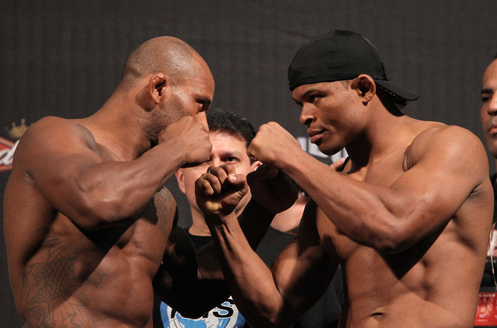 BELO HORIZONTE, BRAZIL - JUNE 22:   (L-R) Opponents Delson Heleno and Francisco Trinaldo face off  during the UFC 147 weigh in at Estádio Jornalista Felipe Drummond on June 22, 2012 in Belo Horizonte, Brazil.  (Photo by Josh Hedges/Zuffa LLC/Zuffa LLC via Getty Images)