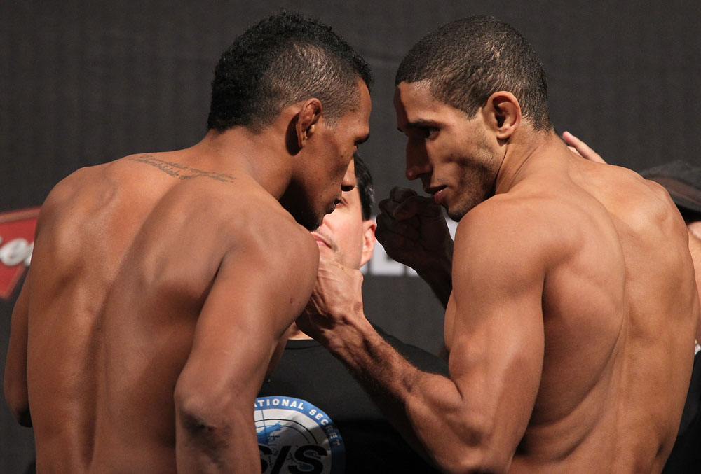 BELO HORIZONTE, BRAZIL - JUNE 22:   (L-R) Opponents Yuri Alcantara and Hacran Dias face off after making weight during the UFC 147 weigh in at Estadio Jornalista Felipe Drummond on June 22, 2012 in Belo Horizonte, Brazil.  (Photo by Josh Hedges/Zuffa LLC/Zuffa LLC via Getty Images)