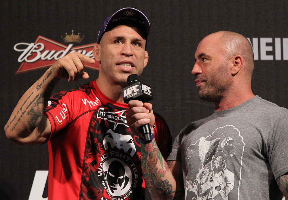 BELO HORIZONTE, BRAZIL - JUNE 22:   (L-R) Wanderlei Silva is interviewed by Joe Rogan after making weight during the UFC 147 weigh in at Estadio Jornalista Felipe Drummond on June 22, 2012 in Belo Horizonte, Brazil.  (Photo by Josh Hedges/Zuffa LLC/Zuffa LLC via Getty Images)