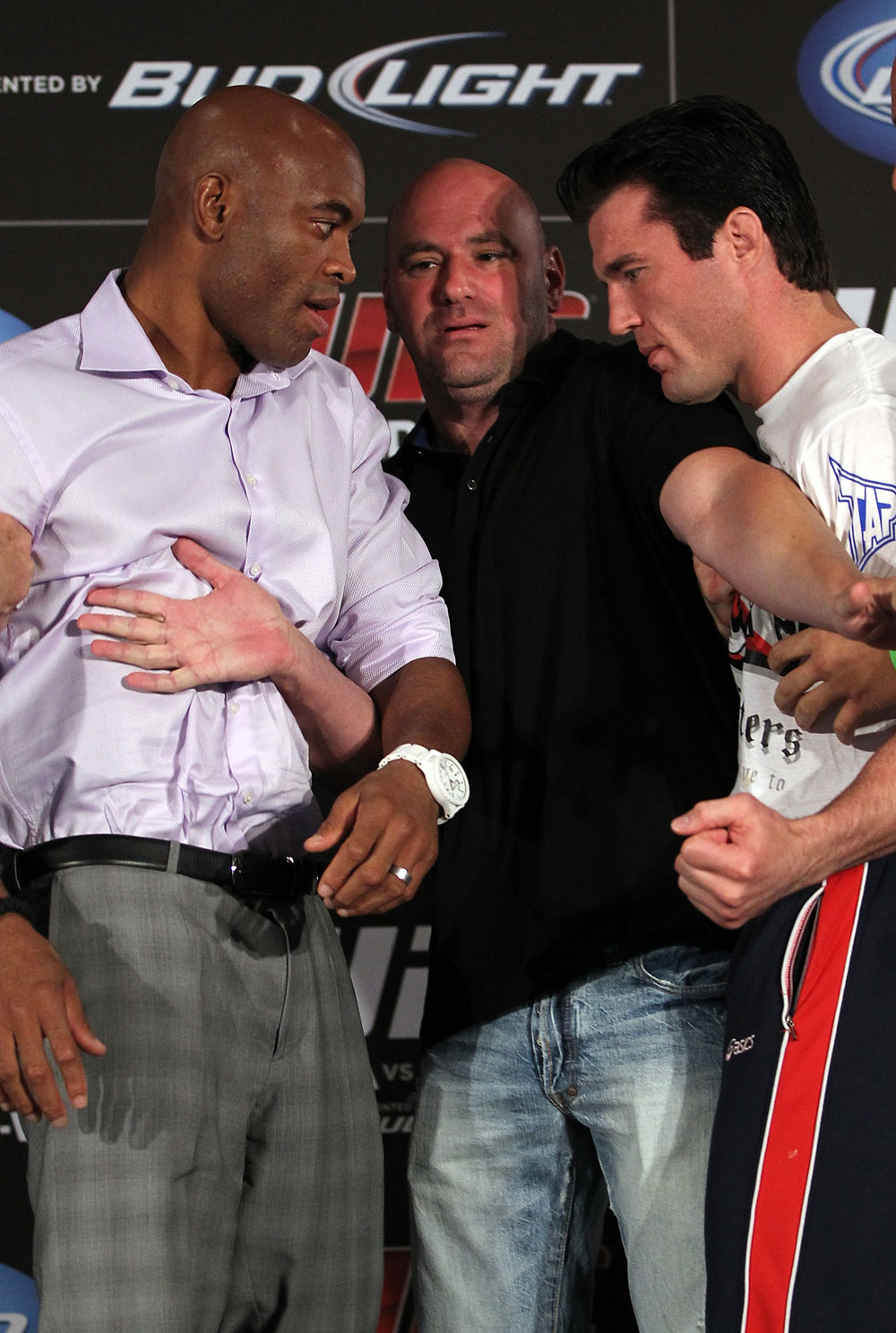 LAS VEGAS, NV - JULY 3:   (L-R) Opponents Anderson Silva and Chael Sonnen are separated by UFC President Dana White during the UFC 148 press conference at Lagasse&#39;s Stadium inside The Palazzo on July 3, 2012 in Las Vegas, Nevada.  (Photo by Josh Hedges/Zuffa LLC/Zuffa LLC via Getty Images)
