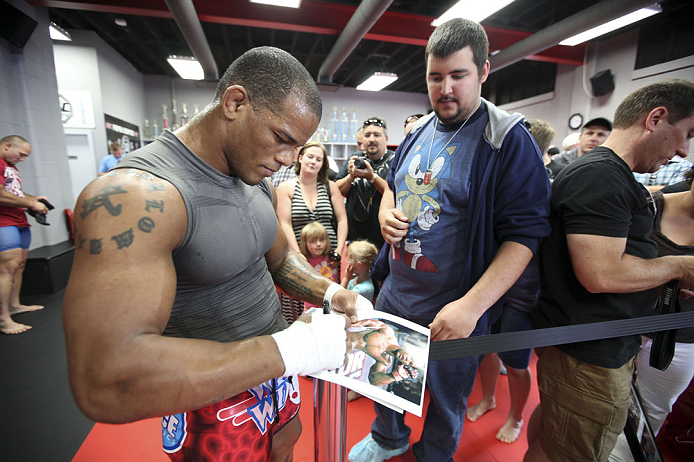 CALGARY, CANADA - JULY 18: Hector Lombard signs autographs after he works out for the fans and media during the UFC 149 Open Workouts inside Champion&#39;s Creed Gym on July 18, 2012 in Calgary, Alberta, Canada.  (Photo by Jeff Bottari/Zuffa LLC/Zuffa LLC via Getty Images)