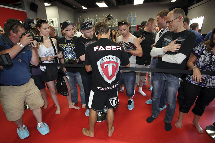 CALGARY, CANADA - JULY 18: Uriah Faber signs autographs after he works out for the fans and media during the UFC 149 Open Workouts inside Champion's Creed Gym on July 18, 2012 in Calgary, Alberta, Canada.  (Photo by Jeff Bottari/Zuffa LLC/Zuffa LLC via Getty Images)