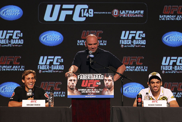 CALGARY, CANADA - JULY 19: (L-R) Urijah Faber, UFC President Dana White and Renan Barao attend the UFC 149 press conference at the Flames Central Sports Club on July 19, 2012 in Calgary, Alberta, Canada. (Photo by Jeff Bottari/Zuffa LLC/Zuffa LLC via Getty Images)