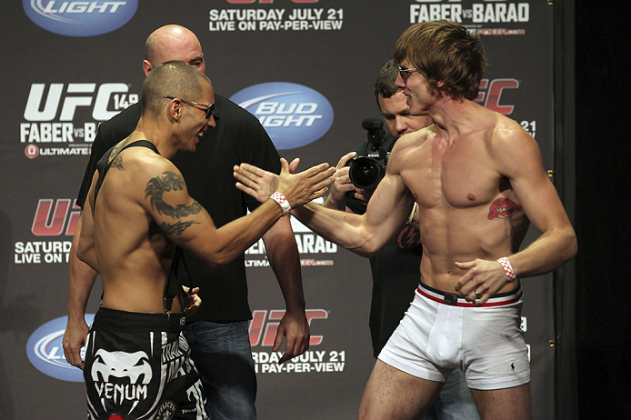 CALGARY, CANADA - JULY 20:  Chris Clements and Matthew Riddle face off at the UFC 149 weigh-in at the Scotiabank Saddledome on July 20, 2012 in Calgary, Alberta, Canada.  (Photo by Jeff Bottari/Zuffa LLC/Zuffa LLC via Getty Images)