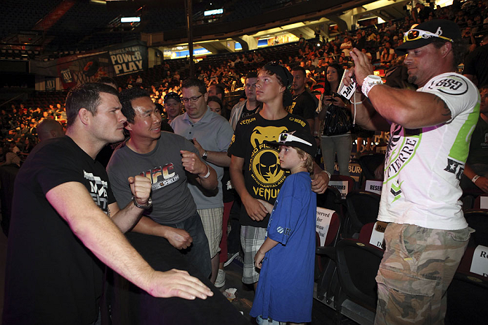 CALGARY, CANADA - JULY 20:  Michael Bisping poses for pictures after a Q&A session with the fans prior to the UFC 149 weigh-in at the Scotiabank Saddledome on July 20, 2012 in Calgary, Alberta, Canada.  (Photo by Jeff Bottari/Zuffa LLC/Zuffa LLC via Getty Images)