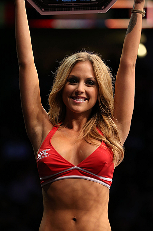DENVER, CO - AUGUST 11:  UFC Octagon Girl Brittney Palmer introduces a round at UFC 150 inside Pepsi Center on August 11, 2012 in Denver, Colorado. (Photo by Josh Hedges/Zuffa LLC/Zuffa LLC via Getty Images)