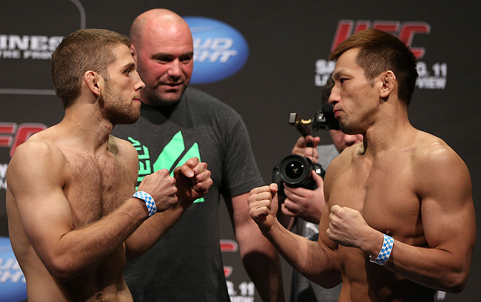 DENVER, CO - AUGUST 10:  (L-R) Opponents Nik Lentz and Eiji Mitsuoka face off during the UFC 150 weigh in at Pepsi Center on August 10, 2012 in Denver, Colorado. (Photo by Josh Hedges/Zuffa LLC/Zuffa LLC via Getty Images)
