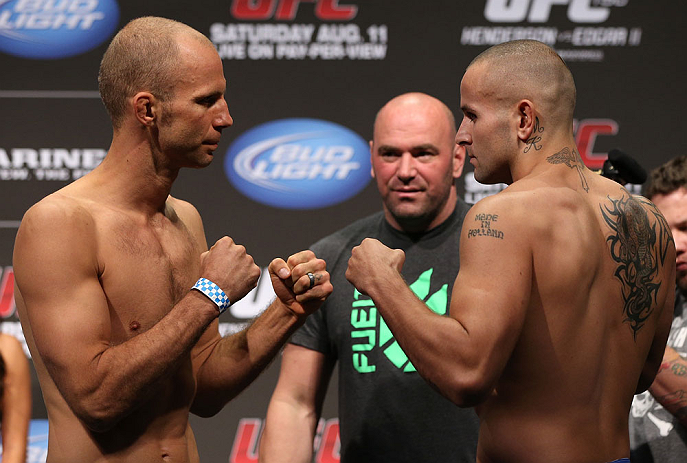 DENVER, CO - AUGUST 10:  (L-R) Opponents Jared Hamman and Michael Kuiper face off during the UFC 150 weigh in at Pepsi Center on August 10, 2012 in Denver, Colorado. (Photo by Josh Hedges/Zuffa LLC/Zuffa LLC via Getty Images)