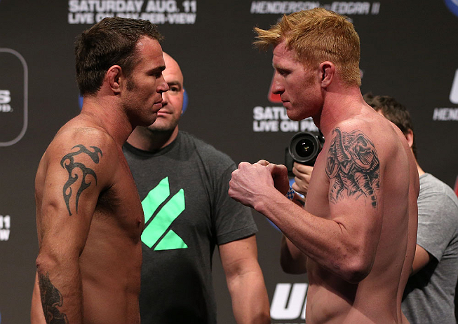 DENVER, CO - AUGUST 10:  (L-R) Opponents Jake Shields and Ed Herman face off during the UFC 150 weigh in at Pepsi Center on August 10, 2012 in Denver, Colorado. (Photo by Josh Hedges/Zuffa LLC/Zuffa LLC via Getty Images)