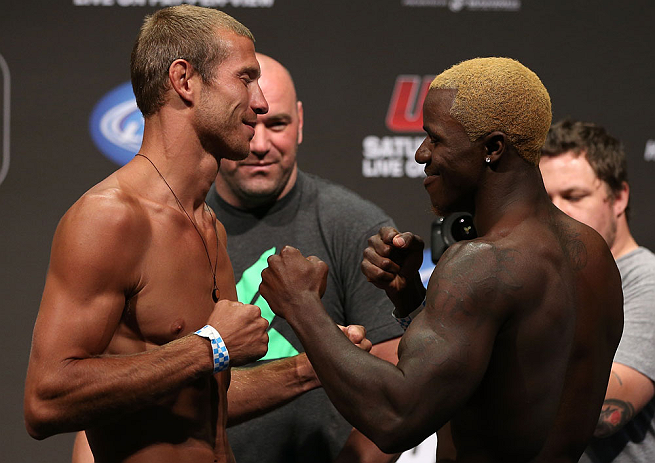 "DENVER, CO - AUGUST 10:  (L-R) Opponents Donald ""Cowboy"" Cerrone and Melvin Guillard face off during the UFC 150 weigh in at Pepsi Center on August 10, 2012 in Denver, Colorado. (Photo by Josh Hedges/Zuffa LLC/Zuffa LLC via Getty Images)"