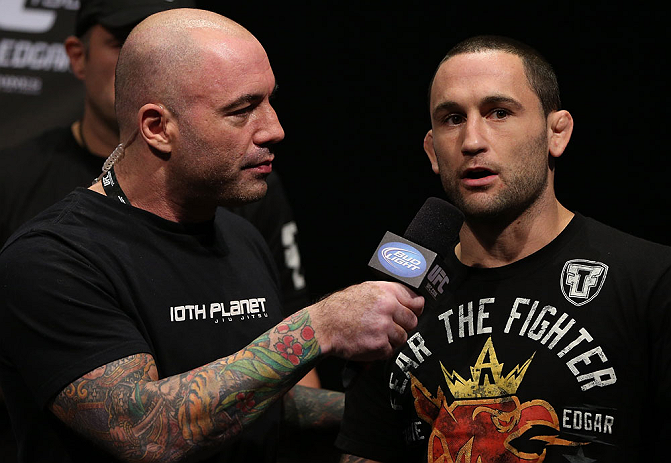 DENVER, CO - AUGUST 10:  (R-L) Frankie Edgar is interviewed by Joe Rogan during the UFC 150 weigh in at Pepsi Center on August 10, 2012 in Denver, Colorado. (Photo by Josh Hedges/Zuffa LLC/Zuffa LLC via Getty Images)
