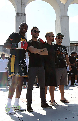 RIO DE JANEIRO, BRAZIL - OCTOBER 10:  Anderson Silva (L) poses for a photo with members of rock band Linkin Park during an open training session ahead of UFC 153 at Arcos da Lapa: Praca Cardeal Camara on October 10, 2012 in Rio de Janeiro, Brazil.  (Photo by Josh Hedges/Zuffa LLC/Zuffa LLC via Getty Images)